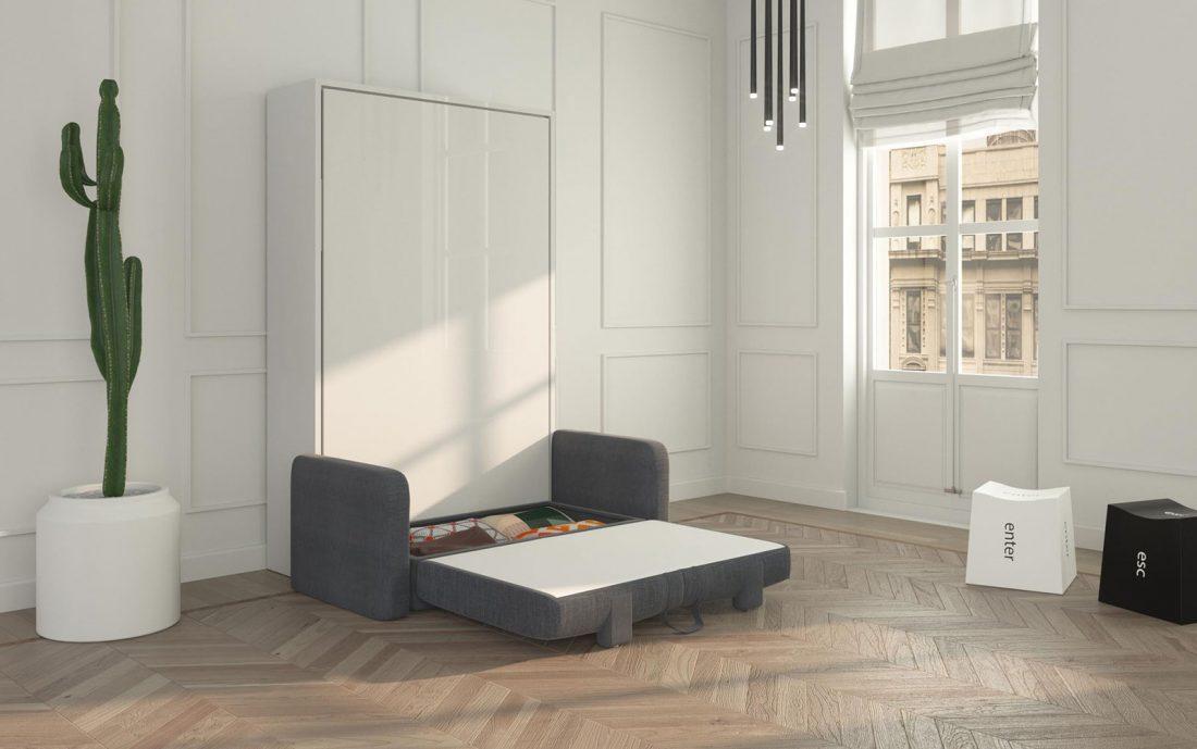 Il contenitore sotto la seduta del divano due posti in cui si possono riporre coperte e cuscini